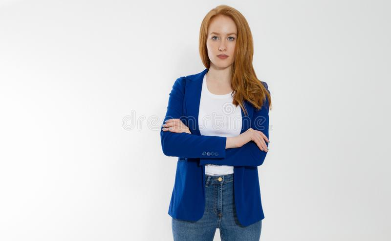 Happy red haired business woman in template blank white t shirt and stylish jacket  on gray background. Self career stock images