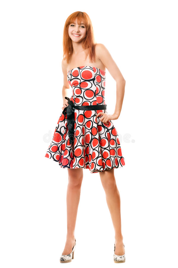 Happy red-haired girl in a dress royalty free stock photography