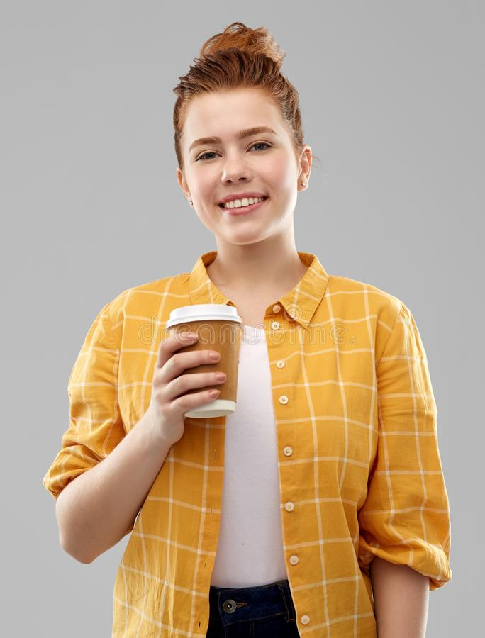 Happy redhead teenage girl with paper coffee cup royalty free stock photos