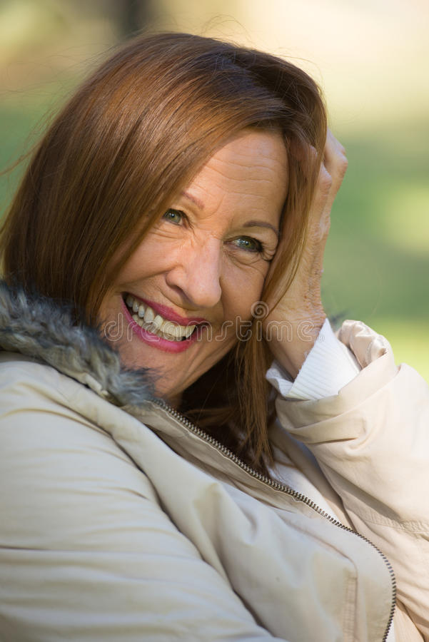 Happy relaxed attractive mature woman stock photos