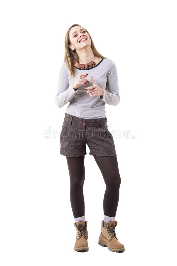 Happy relaxed candid young woman in authentic hipster style clothes talking and gesturing stock photo
