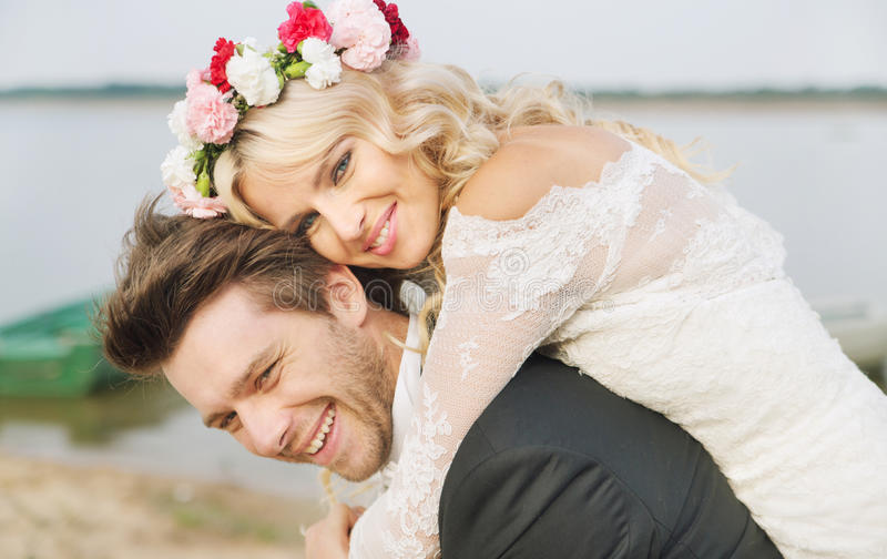 Happy relaxed marriage couple hugging stock images