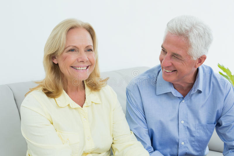 Happy relaxed senior couple at home royalty free stock photos