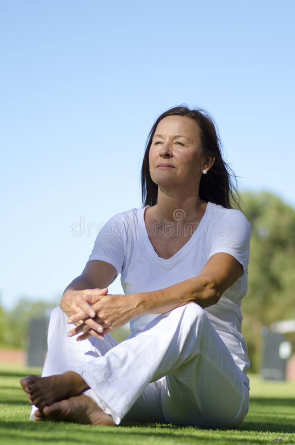 Happy Relaxed Senior Sitting In Park Stock Photography