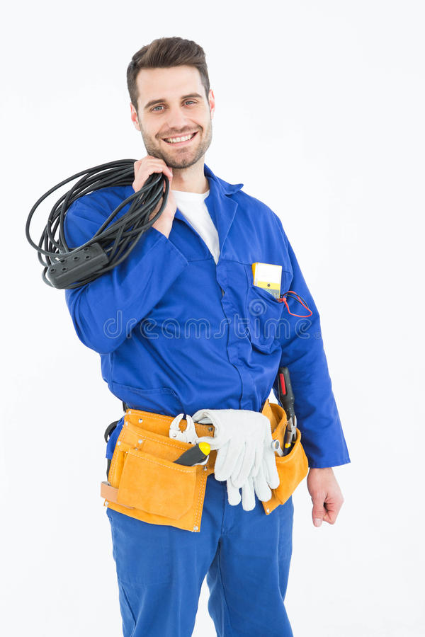 Happy repairman holding cable royalty free stock photography