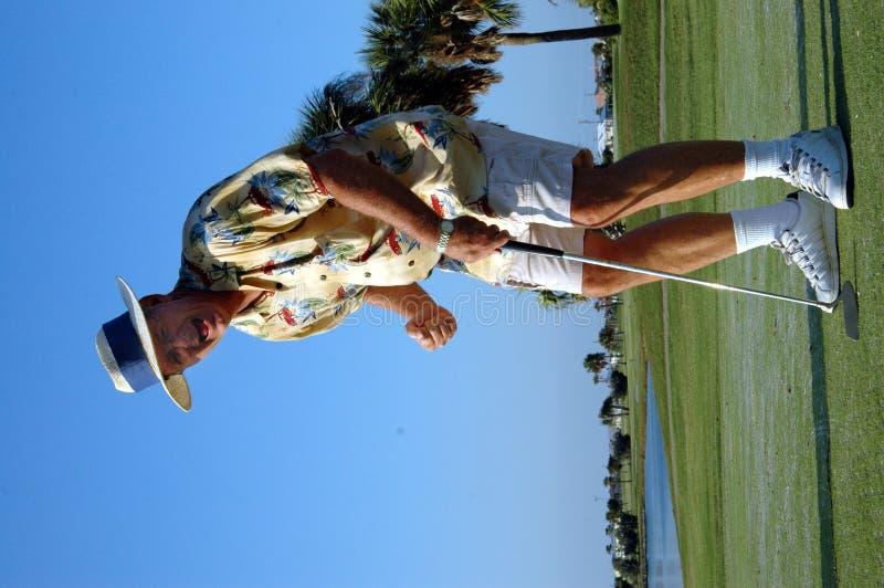 Happy retired golfer stock image