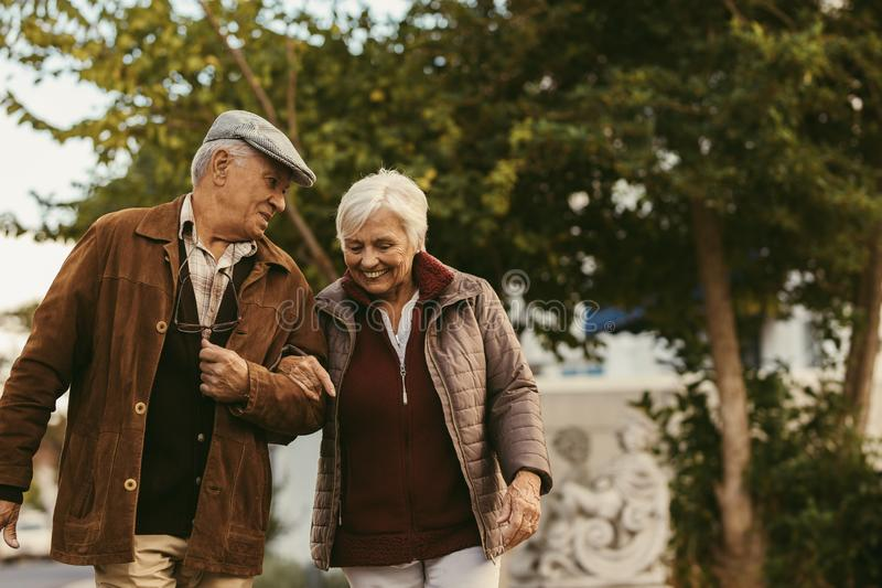 Happy retired walking outdoors on winter day royalty free stock photos