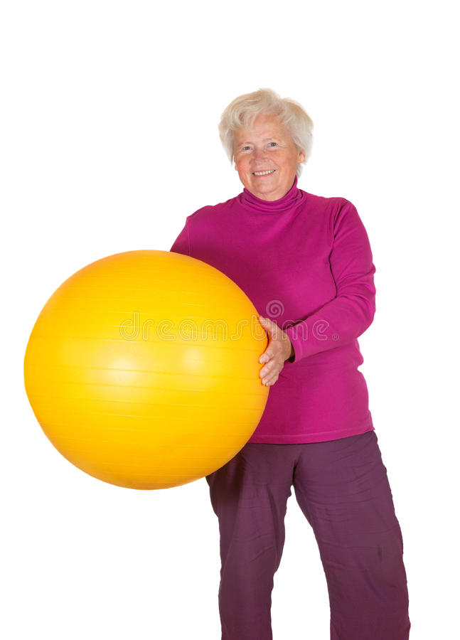 Happy retired woman holding gym ball royalty free stock images