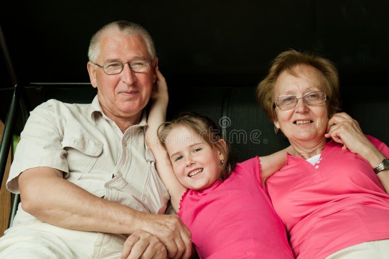 Happy retirement - grandparents with grandchild royalty free stock photo