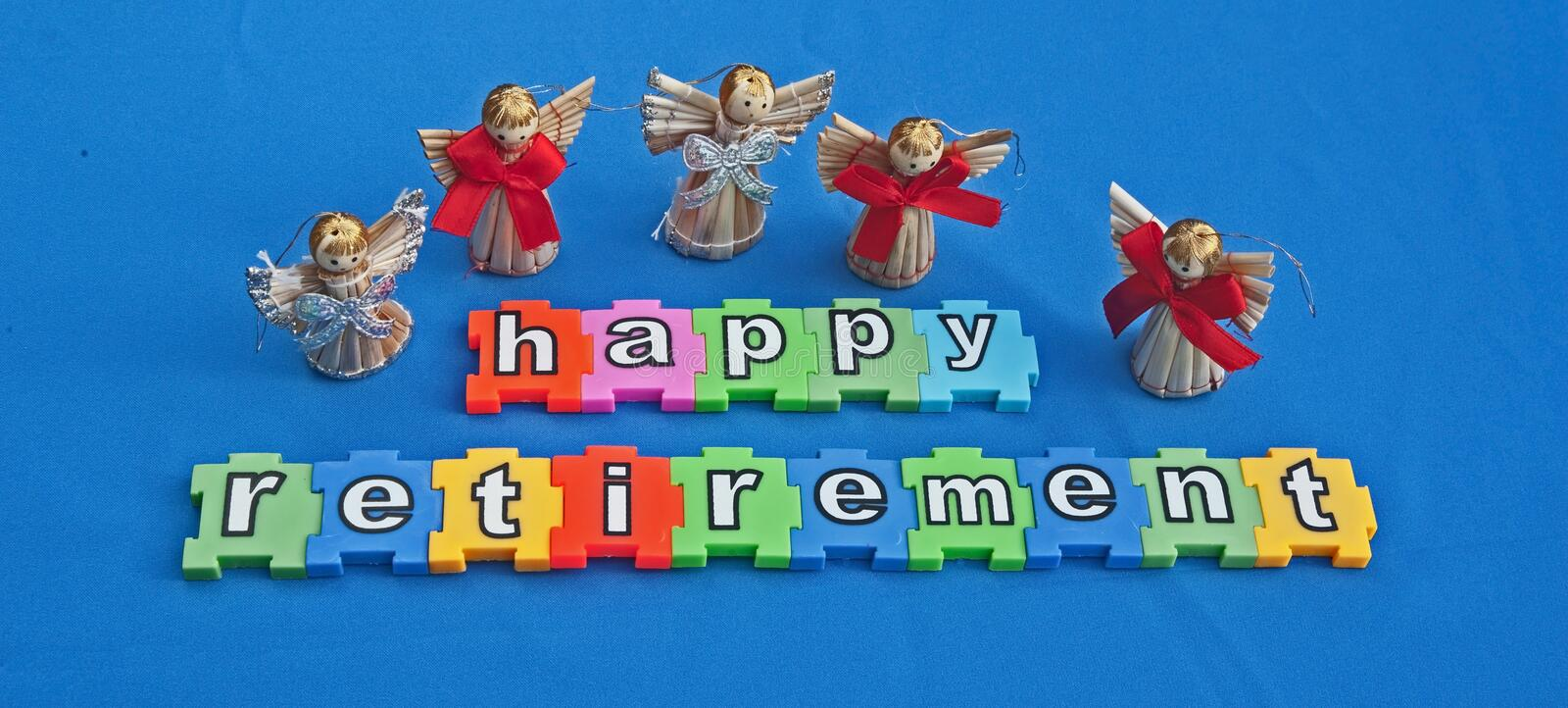 Happy retirement. Message Happy Retirement in lower case white letters on colorful jigsaw style pieces with band of angels above isolated on blue background royalty free stock photo