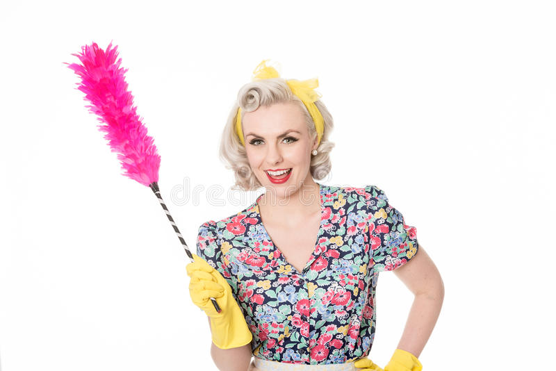 Happy retro housewife, with feather duster, isolated on white. Laughing retro housewife, with feather duster, isolated on white stock photo