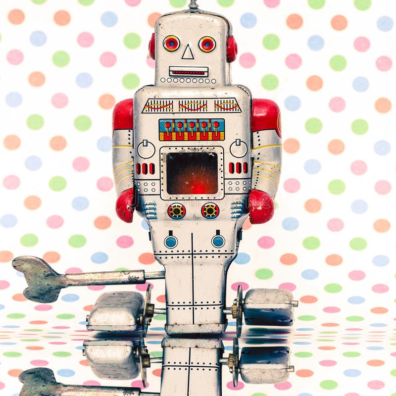 Happy retro robot with color dot background stock photography