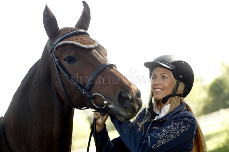 Happy rider with horse. Happy female rider with horse stock photos