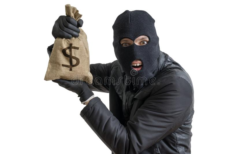 Happy robber is showing stolen bag full of money. Isolated on white. stock photo