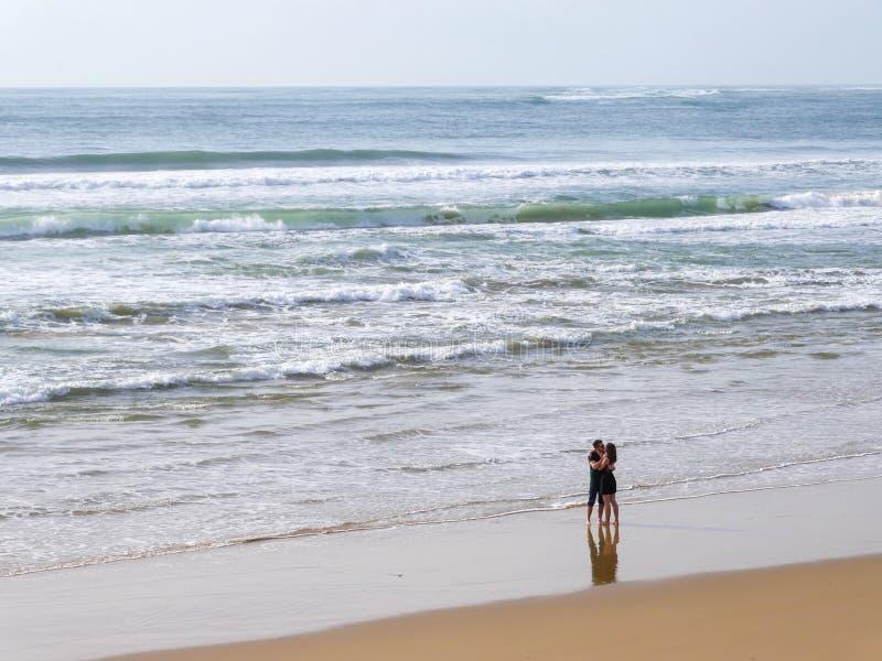 Happy Romantic Couple Enjoying Beautiful Walk on the Beach. Travel Vacation Lifestyle Concept royalty free stock photography