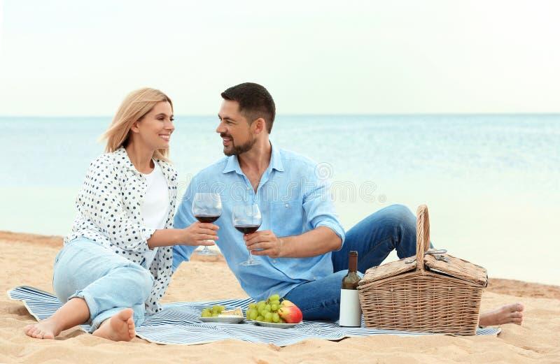 Happy romantic couple having picnic stock image