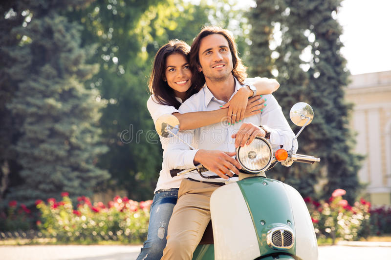Happy Romantic Couple Hugging On Scooter Stock Photo