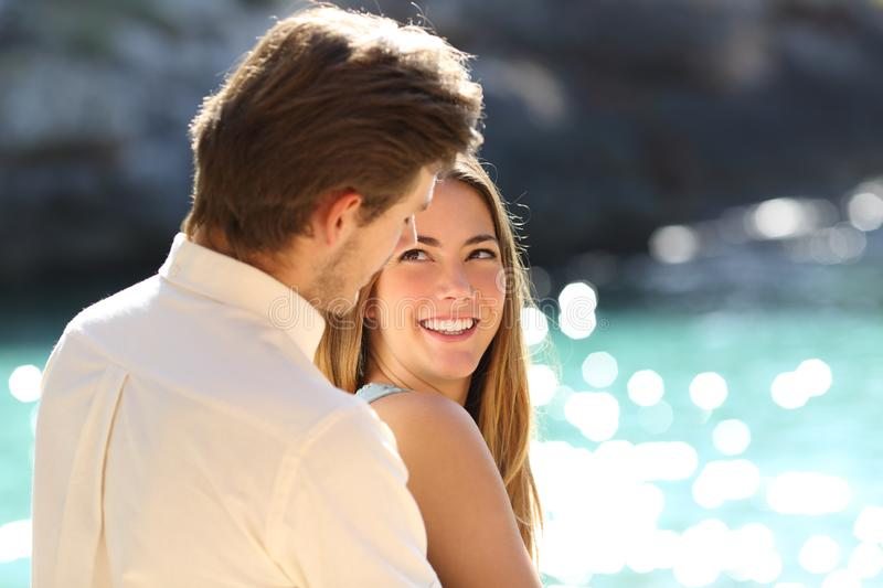 Happy romantic couple in love flirting on vacation royalty free stock images