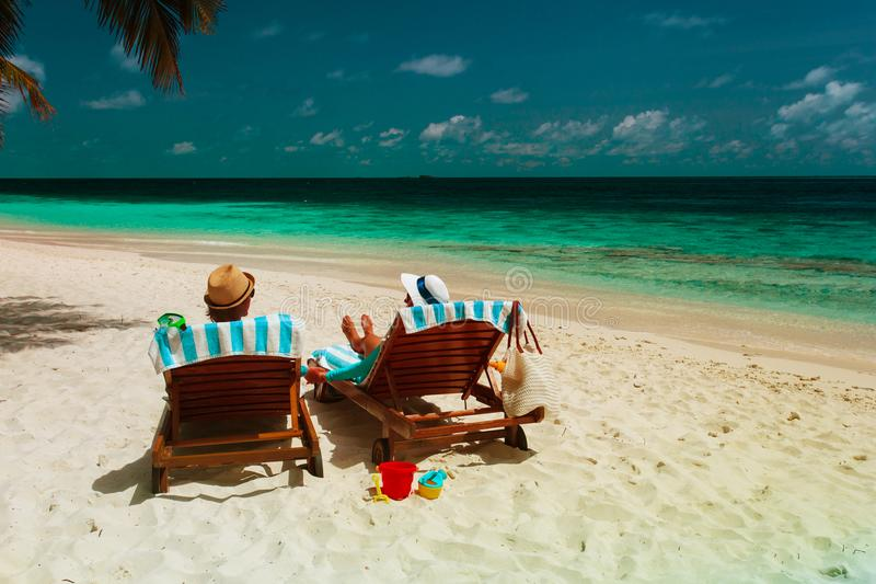 Happy romantic couple relax on a tropical beach stock image