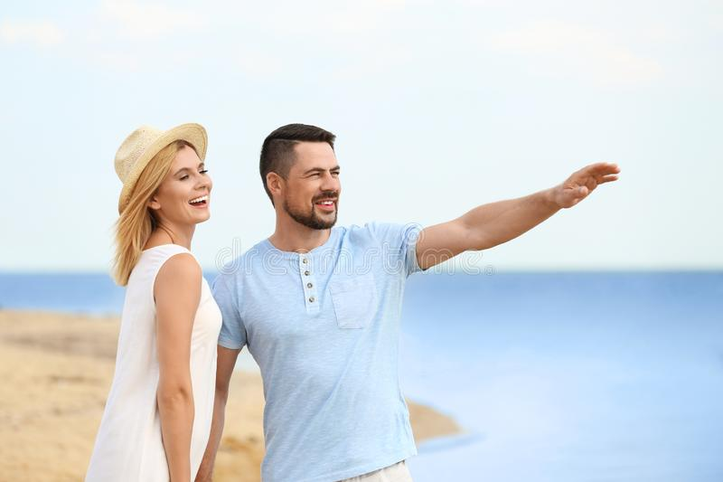 Happy romantic couple spending time together. On beach stock images