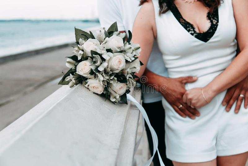 Happy romantic couple walking along the promenade. Honeymoon in Europe stock images