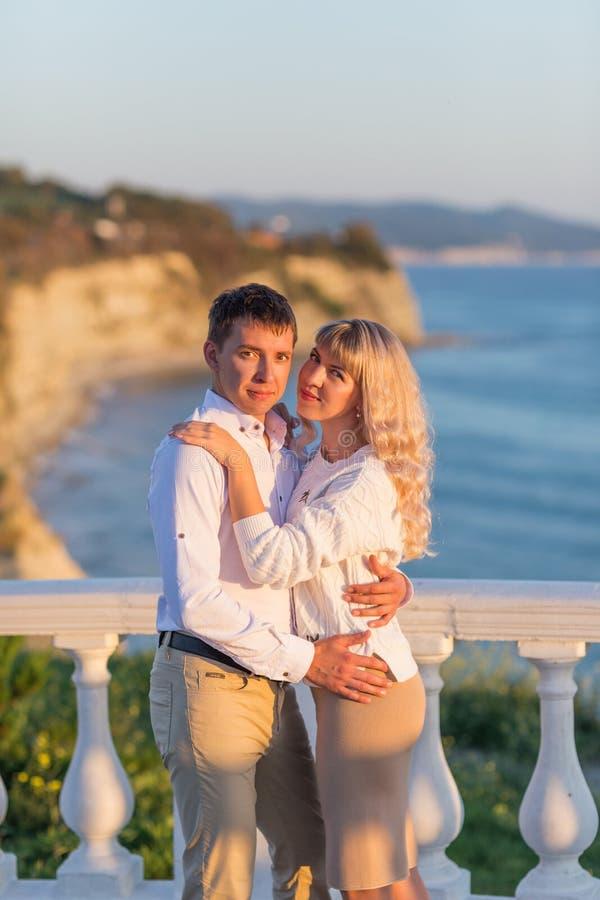 Happy Romantic Young Couple Enjoying Beautiful Sunset Walk on the Black Sea Embankment. Travel Vacation Lifestyle Concept royalty free stock image