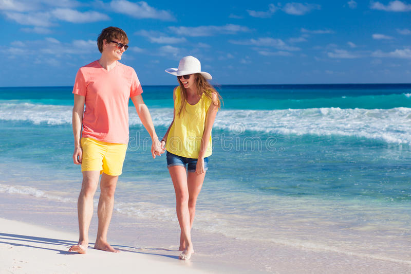 Happy romantic young couple holding hands walking royalty free stock images