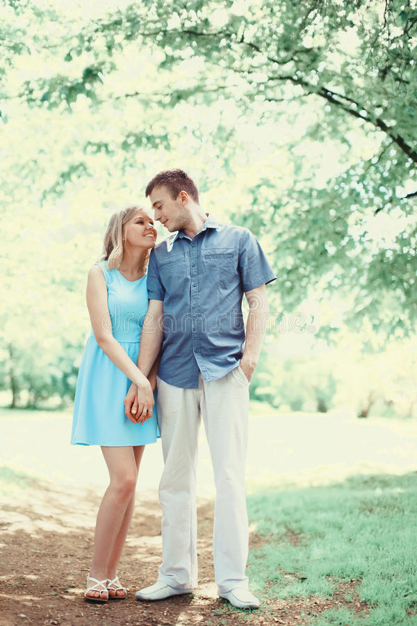 Happy romantic young couple in love walking together in spring stock photos