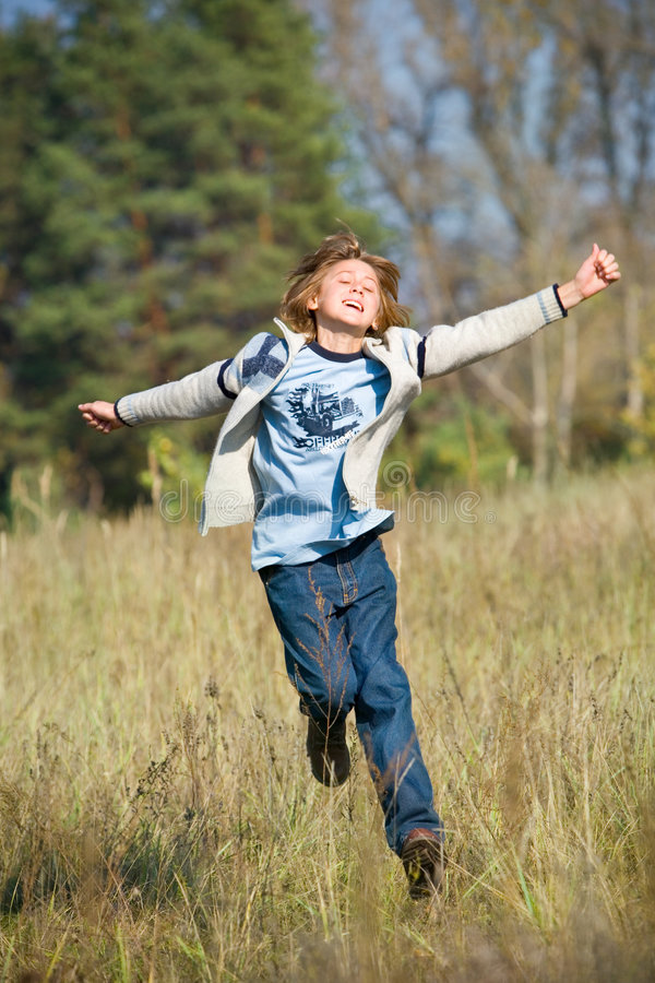 Happy Running Boy Stock Photos
