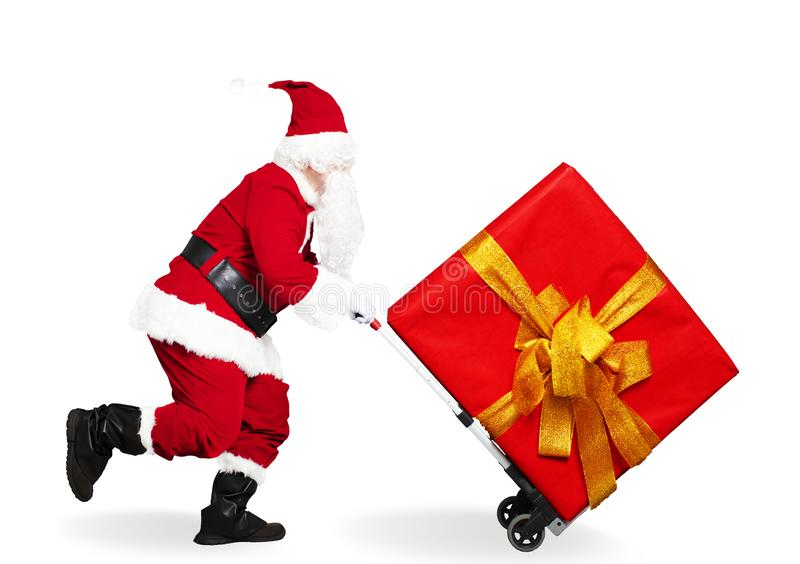 Running Santa Claus with shopping cart trolley. Happy running Santa Claus with shopping cart trolley stock photos