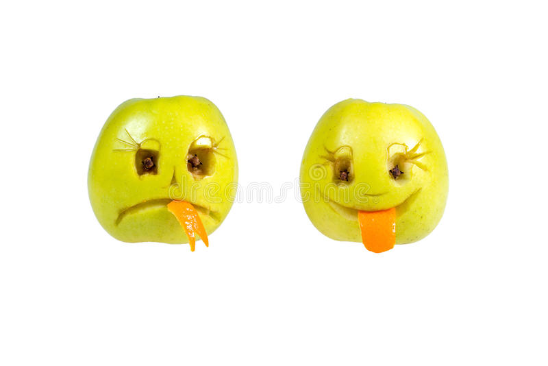 Happy and sad emoticons from apples. Feelings, attitudes. And emotions stock images