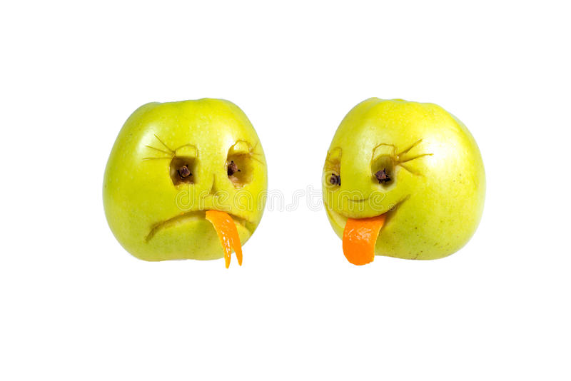 Happy and sad emoticons from apples. Feelings, attitudes. And emotions royalty free stock photography