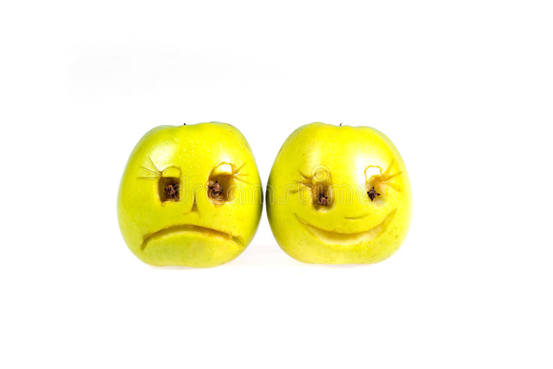 Happy and sad emoticons from apples. Feelings, attitudes and emotions. Happy and sad emoticons from apples. Feelings, attitudes and emotions royalty free stock images
