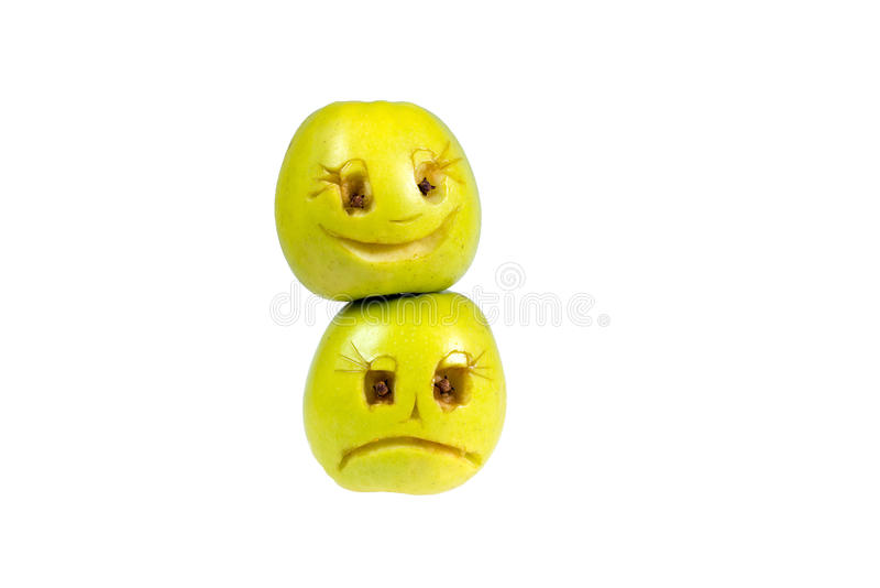 Happy and sad emoticons from apples. Feelings, attitudes. And emotions royalty free stock images