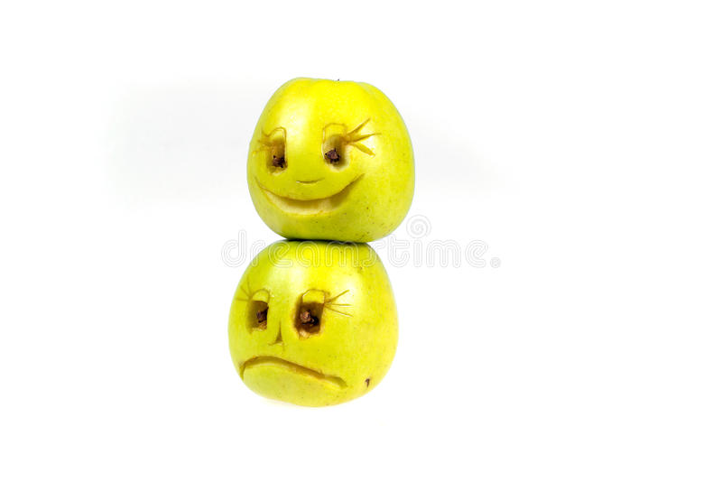 Happy and sad emoticons from apples. Feelings, attitudes and emotions. Happy and sad emoticons from apples. Feelings, attitudes and emotions stock photo