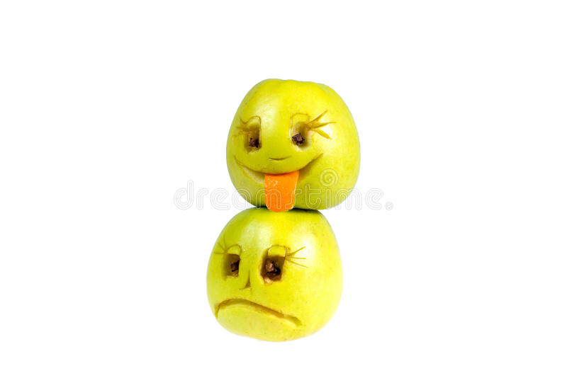 Happy and sad emoticons from apples. Feelings, attitudes. And emotions stock image