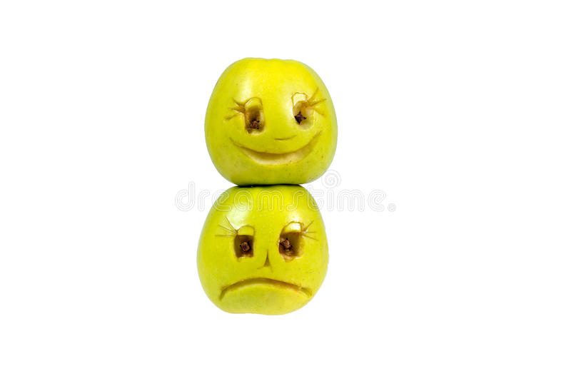Happy and sad emoticons from apples. Feelings, attitudes. And emotions stock photo