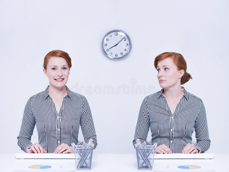 Happy and sad worker. Sitting beside desk royalty free stock photos