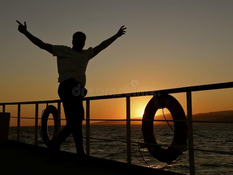 Happy sailing man stock photo