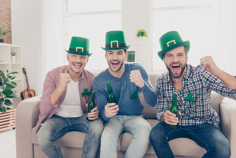 Happy Saint Patrick`s day! Attractive, handsome guys royalty free stock image