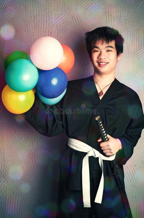 Happy samurai with balloons