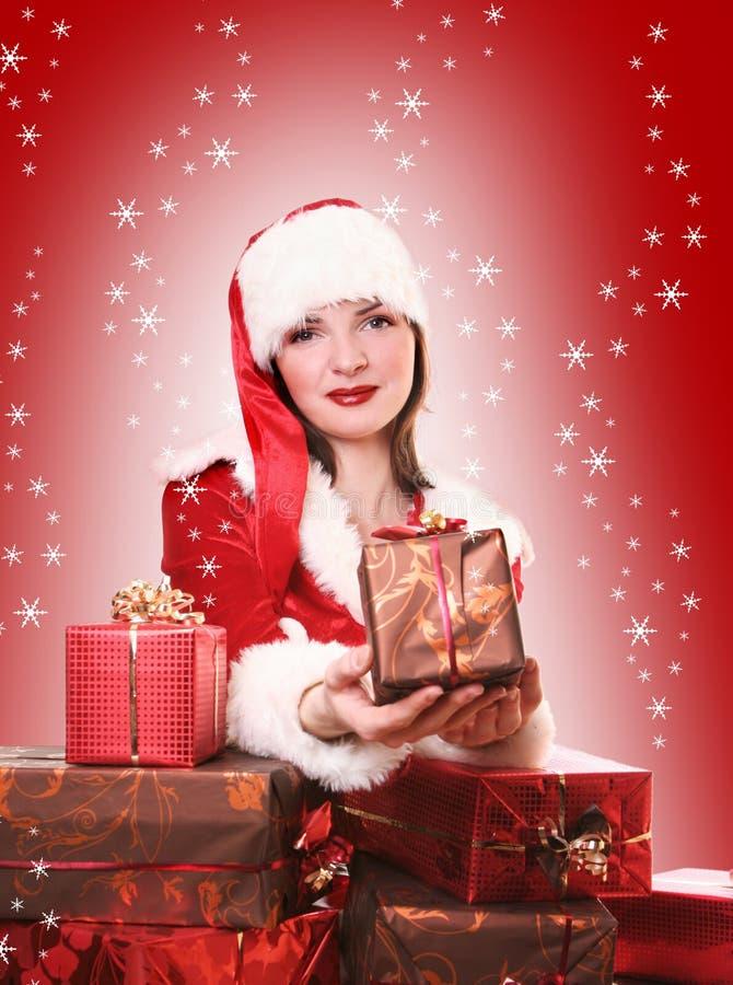 Happy santa. Young Santa-girl with presents royalty free stock photos
