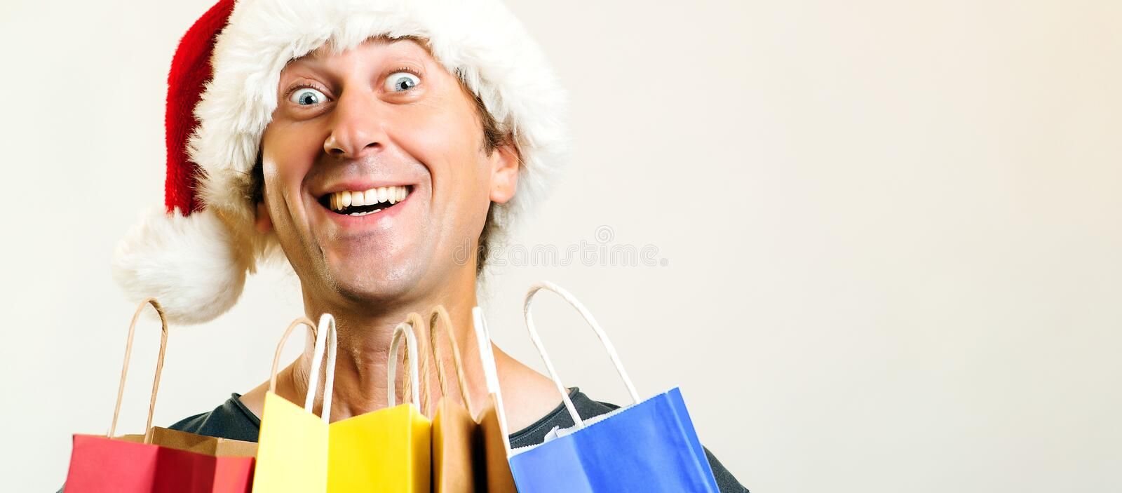 Happy Santa Christmas man with shopping bags, isolated on white background. Holidays, Christmas, sale and people concept. Funny ma royalty free stock photo
