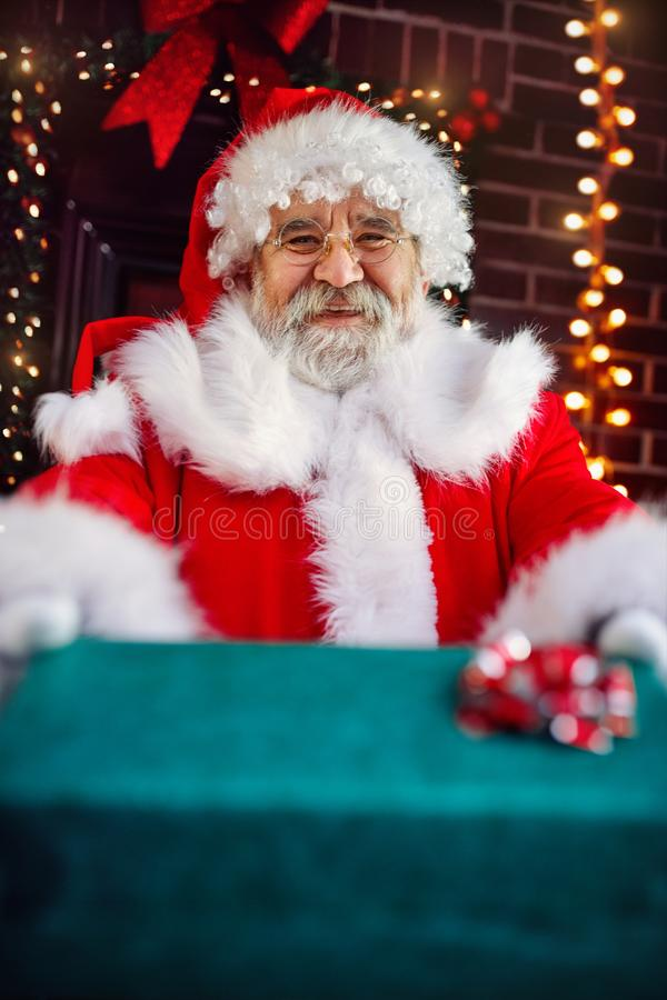 Happy Santa Claus with Christmas gift stock photo