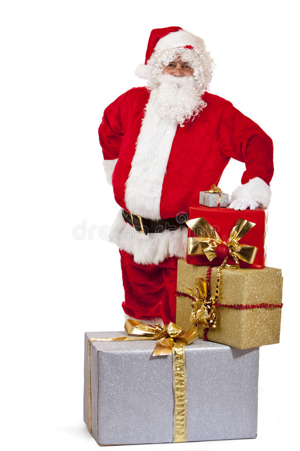 Happy Santa Claus with Christmas gifts stock images