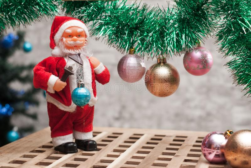 Happy Santa Claus Doll on Christmas time,. Tinsel and balls, festive background royalty free stock photos