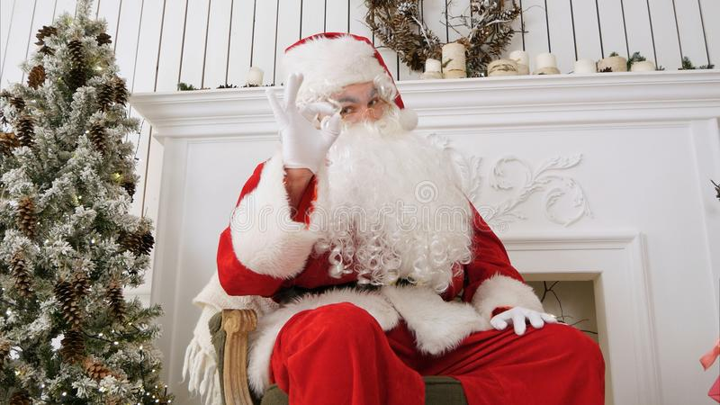 Happy Santa Claus showing okay sign. Professional shot on Lumix GH4 in 4K resolution. You can use it e.g. in your commercial video, business, presentation royalty free stock photos