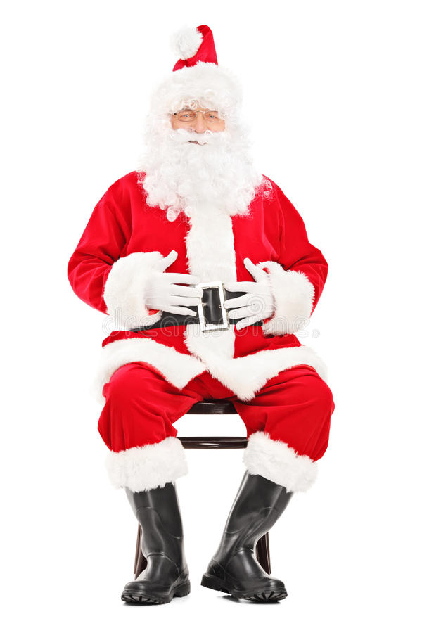 Free Happy Santa Claus Sitting On A Wooden Chair Stock Photography - 34284512