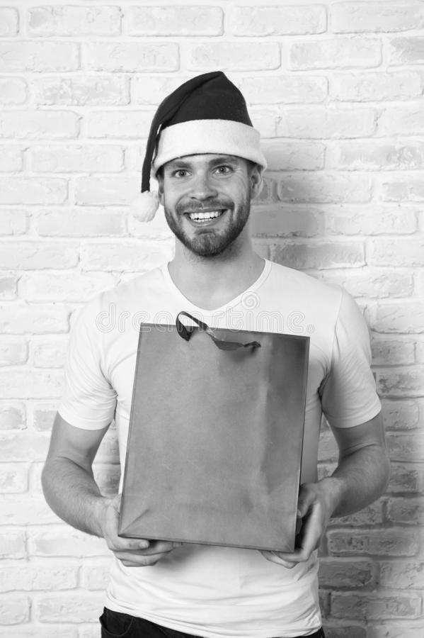 Happy santa man. delivery christmas gift. man in santa hat hold christmas present. online christmas shopping. Happy new stock photos