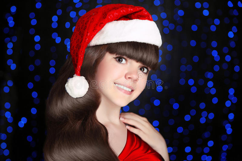 Happy santa teen girl smiling wears in red hat with white fur po stock photography
